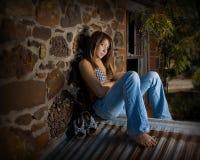 Teenage girl on rooftop. Young teenage girl looking at camera Stock Photo