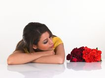 Teenage girl with roses Stock Images