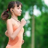 Teenage girl running in green park Stock Photo