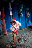 Teenage girl running rain. Annapurna sanctuary village farmland  Nepal teenage girl running rain Royalty Free Stock Photography