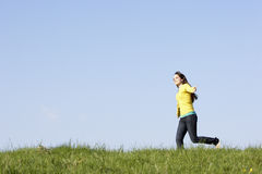 Teenage Girl Running Through Summer Meadow Royalty Free Stock Photo