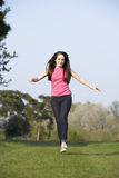Teenage Girl Running Through Summer Meadow Stock Photography