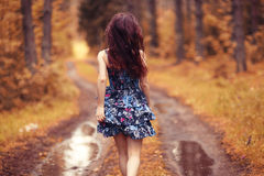 Teenage girl runs in forest Royalty Free Stock Images