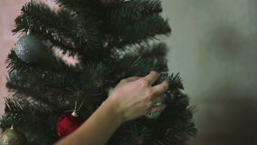Teenage girl`s hands is decorating a Christmas tree stock video footage