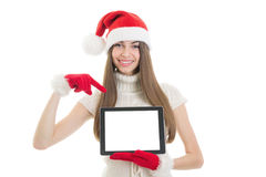 Teenage girl with Santa hat showing tablet computer screen Royalty Free Stock Photography