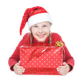Teenage girl in santa helper hat with gift Royalty Free Stock Photos