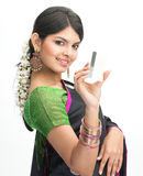 Teenage girl in sari with credit card Stock Photography