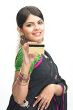 Teenage girl in sari with credit card Royalty Free Stock Images