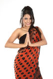 Teenage girl with sari in namaskaram pose Stock Photo