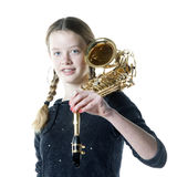 Teenage girl with saxophone in studio with white background Royalty Free Stock Photos
