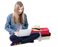 Teenage girl seated with a laptop Royalty Free Stock Images