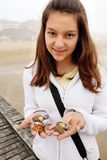 Teenage girl with shells Stock Images