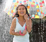 Teenage Girl Sheltering From Rain Beneath Umbrella. Smiling Stock Photos