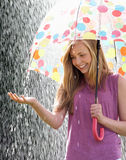 Teenage Girl Sheltering From Rain Beneath Umbrella. Smiling Stock Image