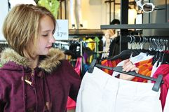 Teenage girl shopping Stock Images