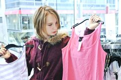 Teenage girl shopping. For clothes and accessories royalty free stock photo