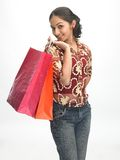 Teenage girl with the shopping bags Stock Photos