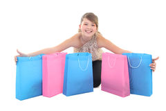 Teenage girl with shopping bags over white Stock Image