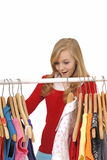 Teenage girl shopping for clothes. Happy blond teenage girl shopping for clothes Stock Photos