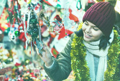 Teenage girl shopping at festive fair before Xmas Stock Photos