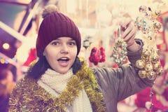 Teenage girl shopping at festive fair before Xmas Royalty Free Stock Image