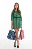 Teenage girl shopping. Full length of pretty teenage girl holdin Royalty Free Stock Photo