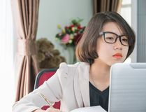 Teenage girl working on laptop in home office Stock Images