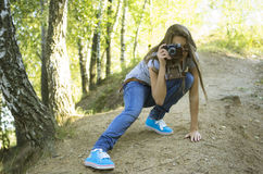 Teenage girl  shoting  in the park Royalty Free Stock Image