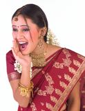 Teenage  girl in a shouting expression. With red silk sari Royalty Free Stock Photography