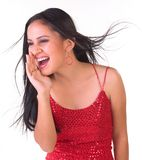 Teenage girl in a shouting expression. Teenage girl with red skirt in a shouting expression Stock Photography