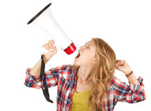 Teenage girl shouting through megaphone Royalty Free Stock Photo