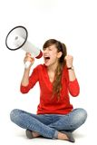 Teenage girl shouting through megaphone Stock Photo