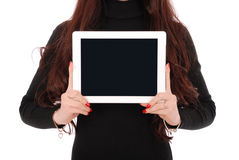 Teenage girl showing a blank horisontal tablet screen. Isolated on white Stock Images
