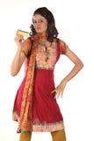 Teenage girl showing gold card. Beautiful Teenage girl showing gold card Royalty Free Stock Photo