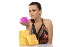 Teenage girl showing her gift Royalty Free Stock Photos