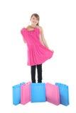 Teenage girl showing new dress Stock Photos