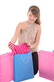 Teenage girl showing new dress after shopping Royalty Free Stock Photo
