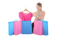 Teenage girl showing new dress with shopping bags royalty free stock image
