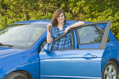 Teenage girl Showing off her car keys. A very happy teenage girl showing car keys, ready to drive a car stock images
