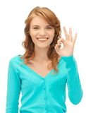 Teenage girl showing ok sign. Bright picture of teenage girl showing ok sign Stock Image