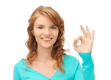 Teenage girl showing ok sign Royalty Free Stock Image