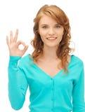 Teenage girl showing ok sign Stock Photography