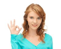 Teenage girl showing ok sign Royalty Free Stock Photos