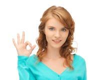 Teenage girl showing ok sign Royalty Free Stock Photos