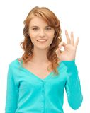 Teenage girl showing ok sign Royalty Free Stock Images