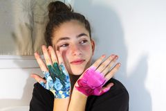 A teenage girl. Showing painted hands royalty free stock images
