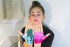 A teenage girl. Showing painted hands royalty free stock photography