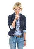 Teenage girl showing shh gesture Stock Photos