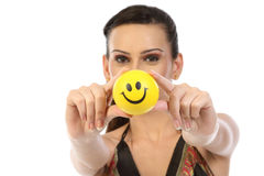 Teenage girl showing smile ball Stock Images