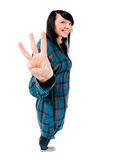 Teenage girl showing three fingers Stock Photos